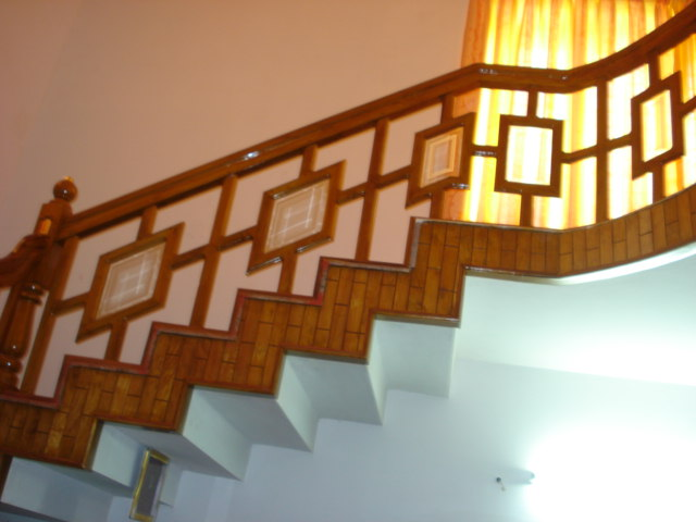 STAIR CASE WITH GLASS AND TEAKWOOD.